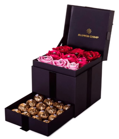 a stylish black box with nine roses in varying shades of red, and a set of chocolates in a pull-out compartment underneath.