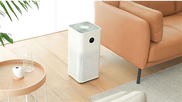 air purifier beside a sofa