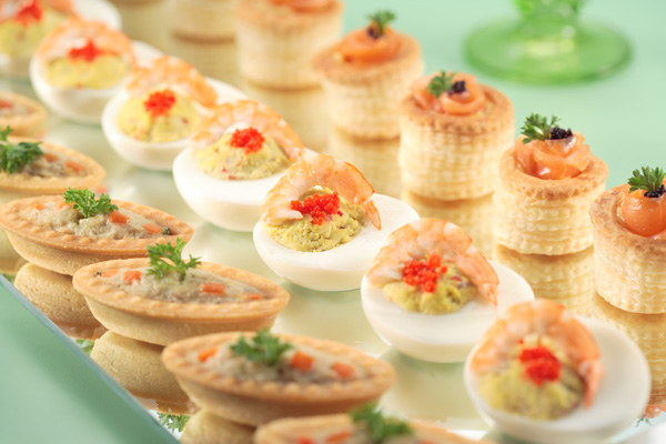 Bite-sized buffet-catering morsels lined up on a plate