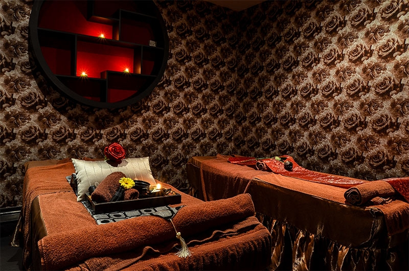 Cosy interior of a Thai massage room in Le Spa with two massage beds