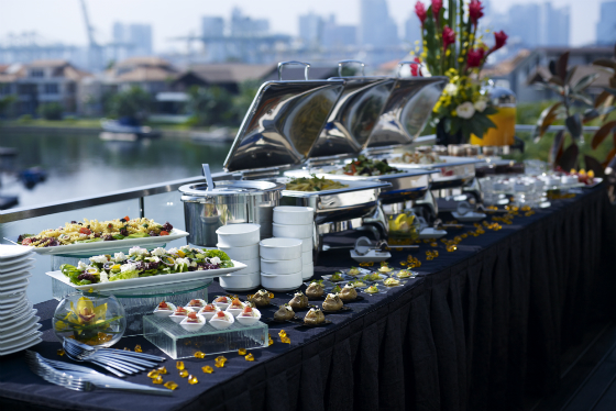 Buffet catering setup in Singapore overlooking a river