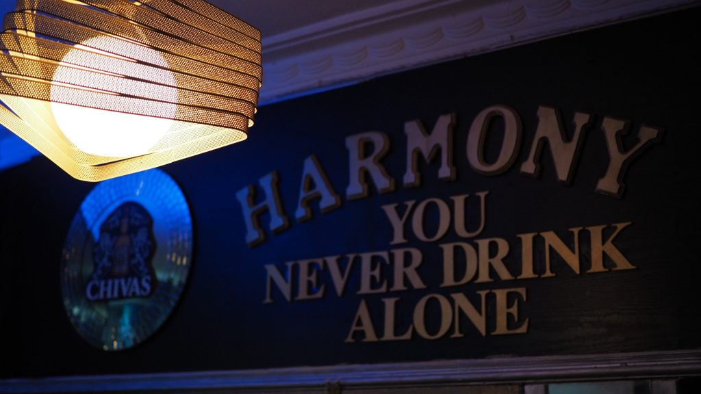 Signboard for Harmony KTV, a karaoke place in Singapore