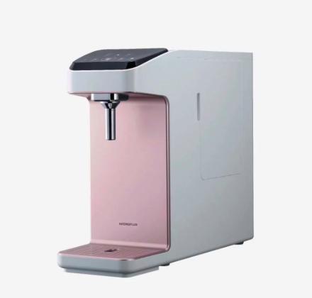 A pink bottleless water dispenser by Hydroflux