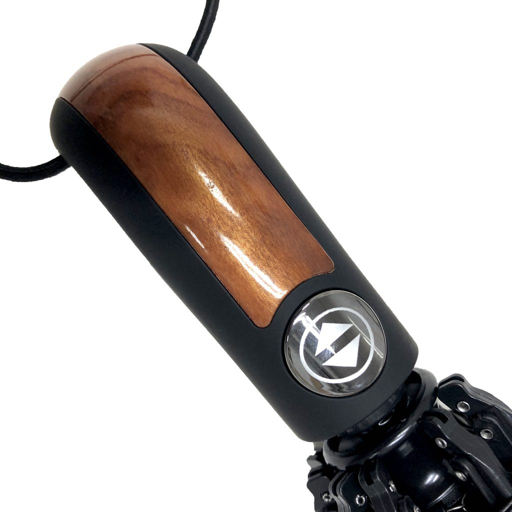 The handle of the Hailstorm umbrella with its partial wood finishing and open-close button