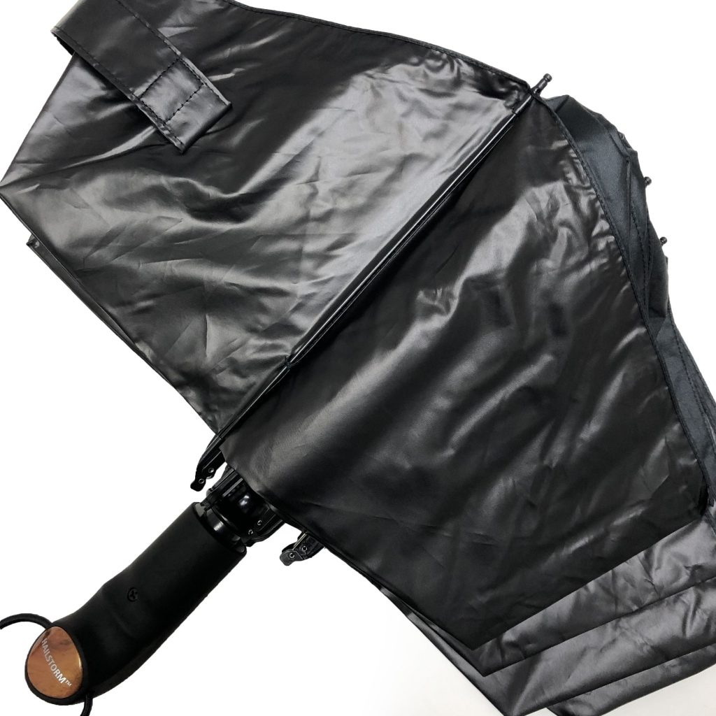 The Hailstorm umbrella in an unstrapped position, laid out on a flat surface