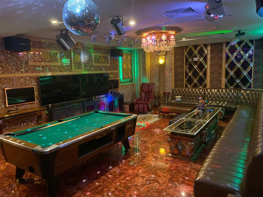 Party world ktv room with disco ball lights and a billiard table