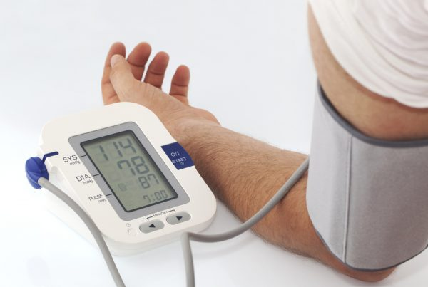 Man using a blood pressure monitor to conduct a blood pressure test