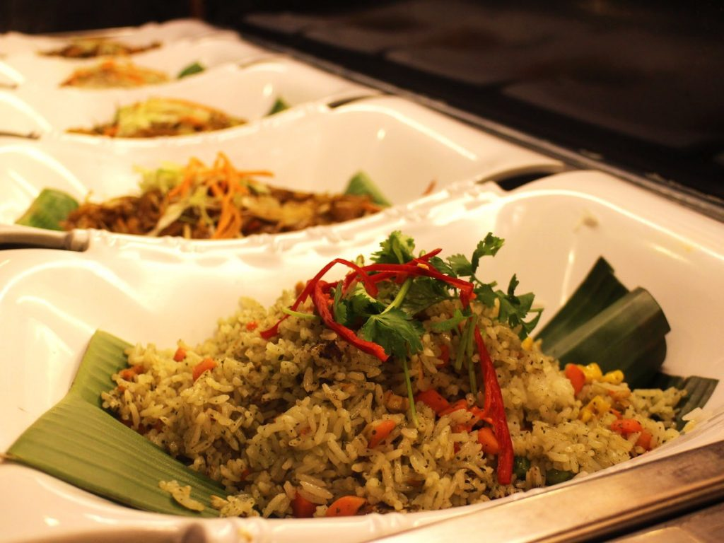 Vegetarian buffet spread, which includes rice