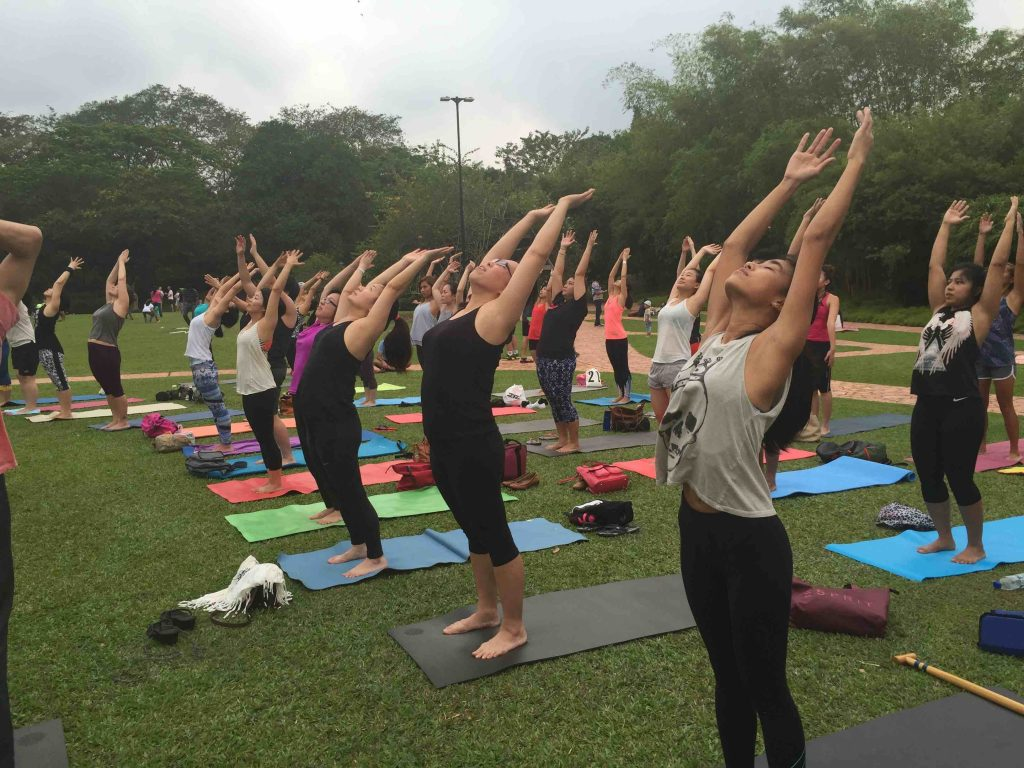 Masters' Sadhan Yoga participants in a park