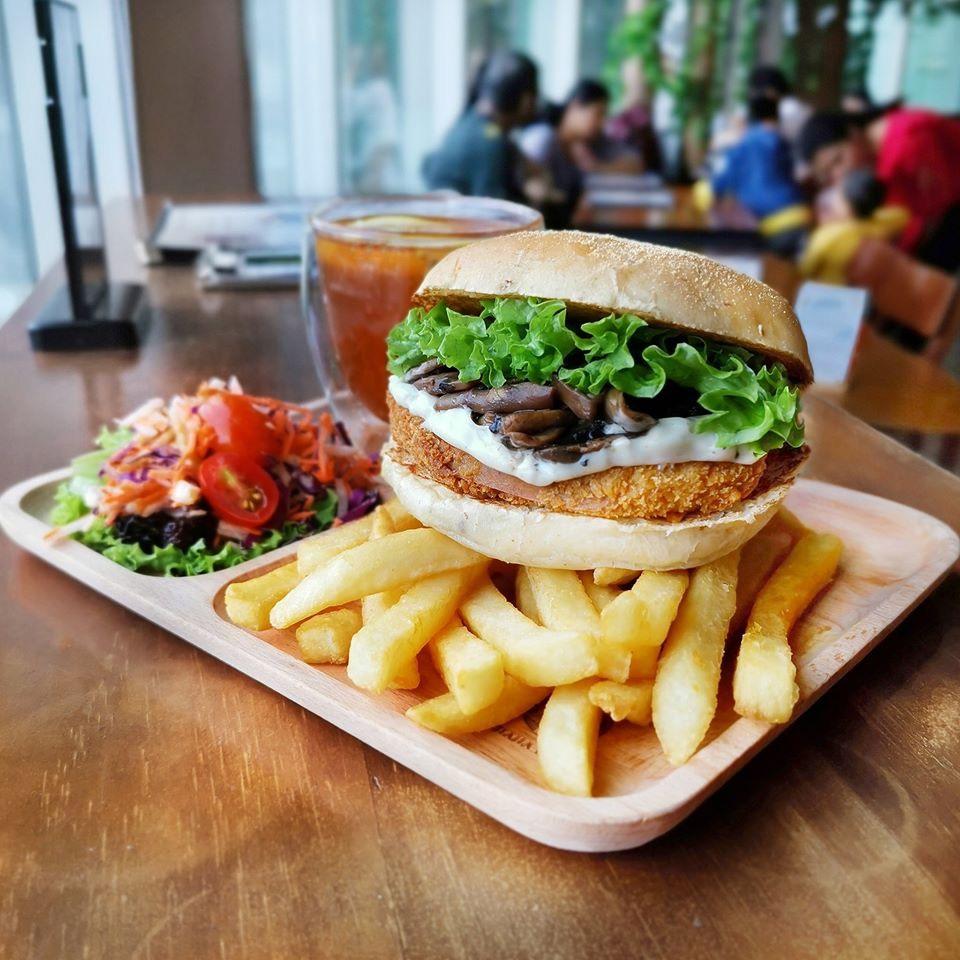 vegan burger with fries, salad, and tea