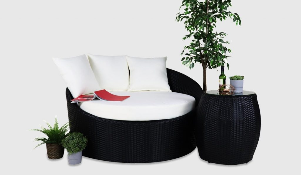 Round sofa with cushions and coffee table