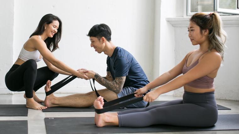 Yoga movement students in studio in Singapore