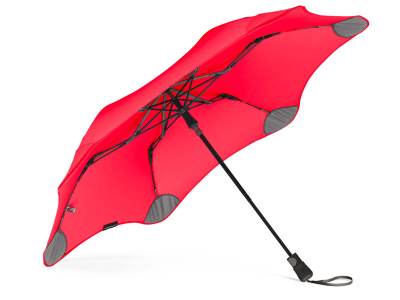An open Blunt umbrella resting on the ground, available for purchase in Singapore