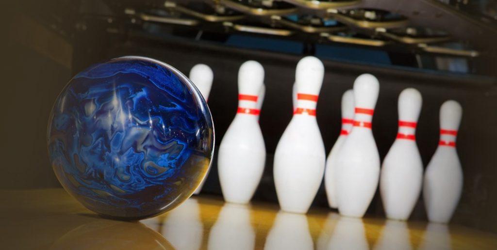 Blue bowling ball and pins at changi resort bowl alley