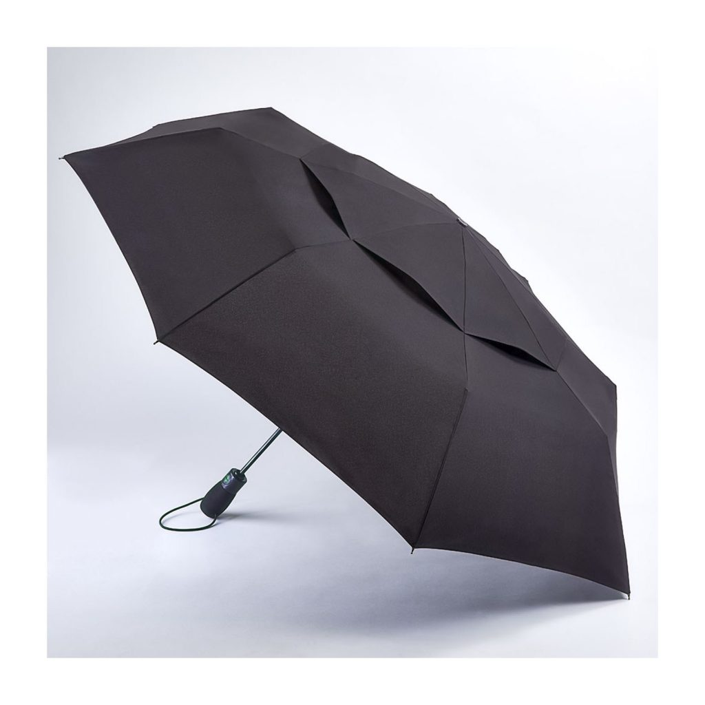An open Fulton umbrella resting on the ground, available for purchase in Singapore