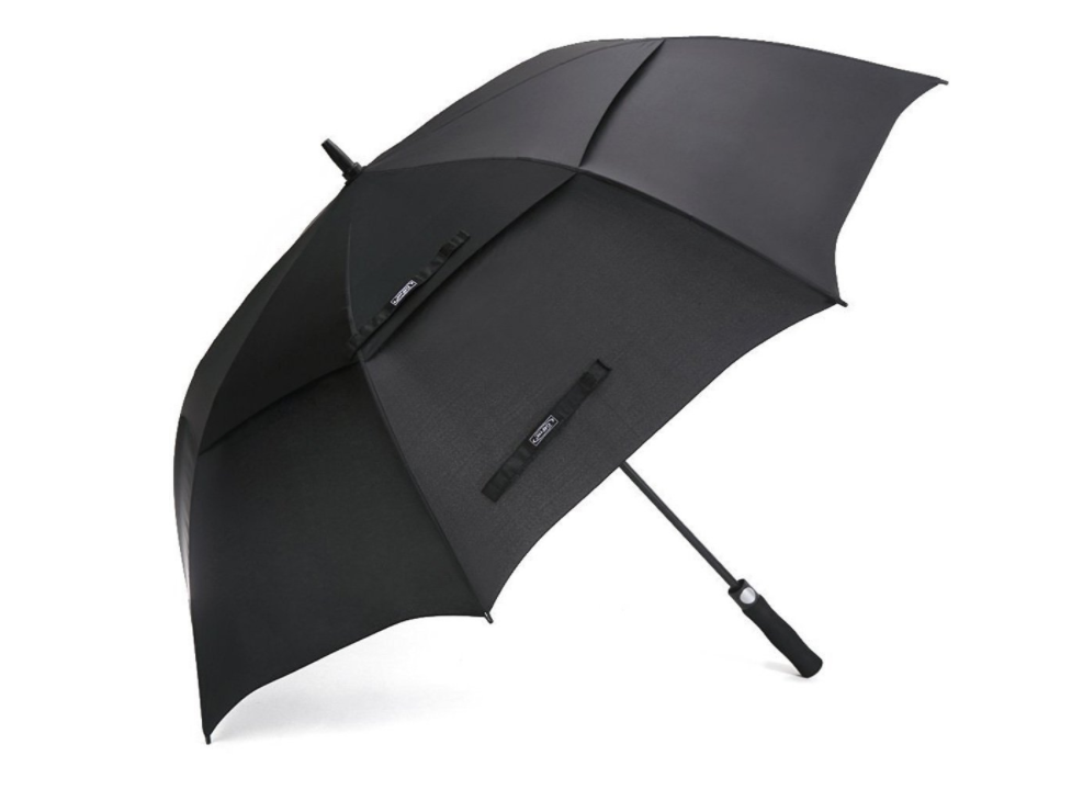 An open G4Free umbrella resting on the ground