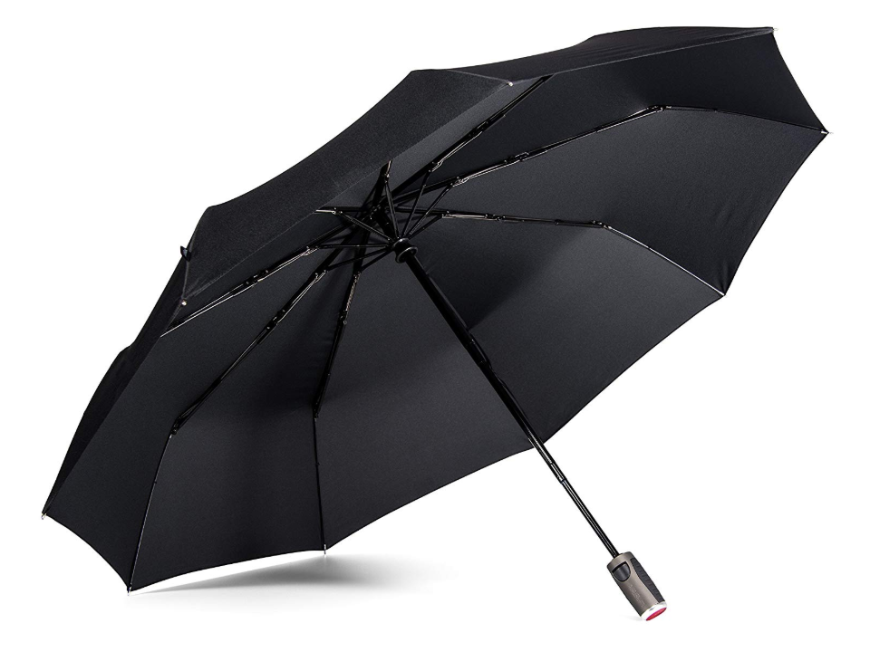 An open Lifetek umbrella resting on the ground, available for purchase in Singapore