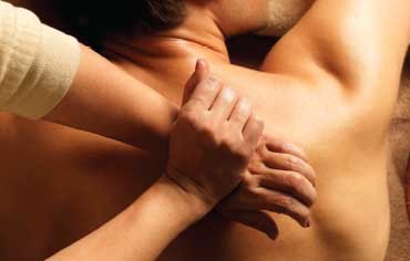 An individual getting a back massage