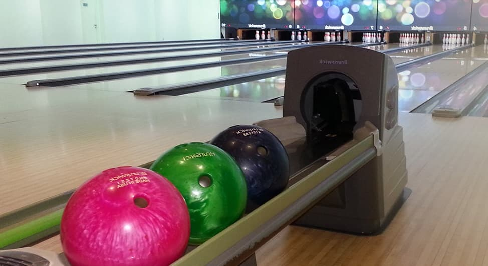 bowling alley and balls in planet bowl singapore