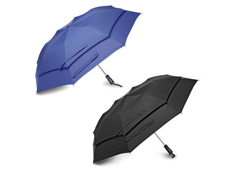 Two open Samsonite umbrellas resting on the ground, available for purchase in Singapore