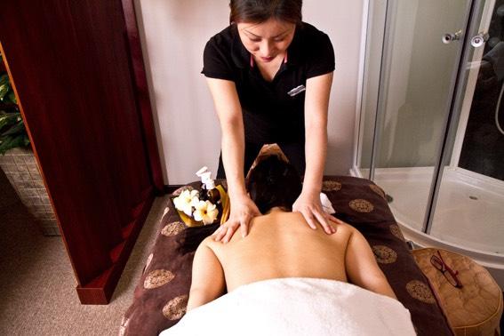A woman massaging an individual