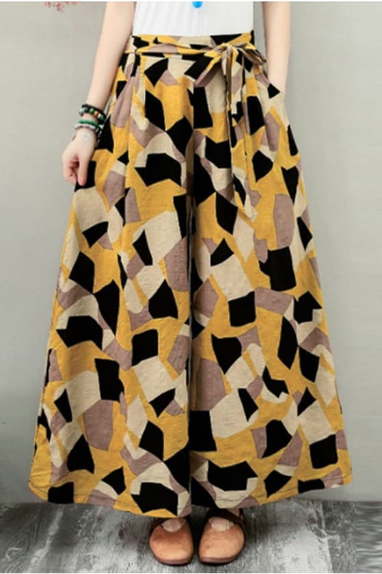 A pair of yellow printed culottes