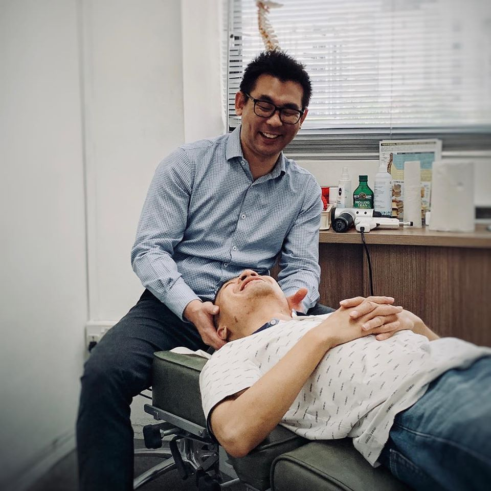 chiropractor checking up on his clients neck