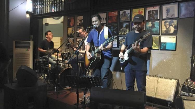 group of men performing live at barbershop at timbre in singapore