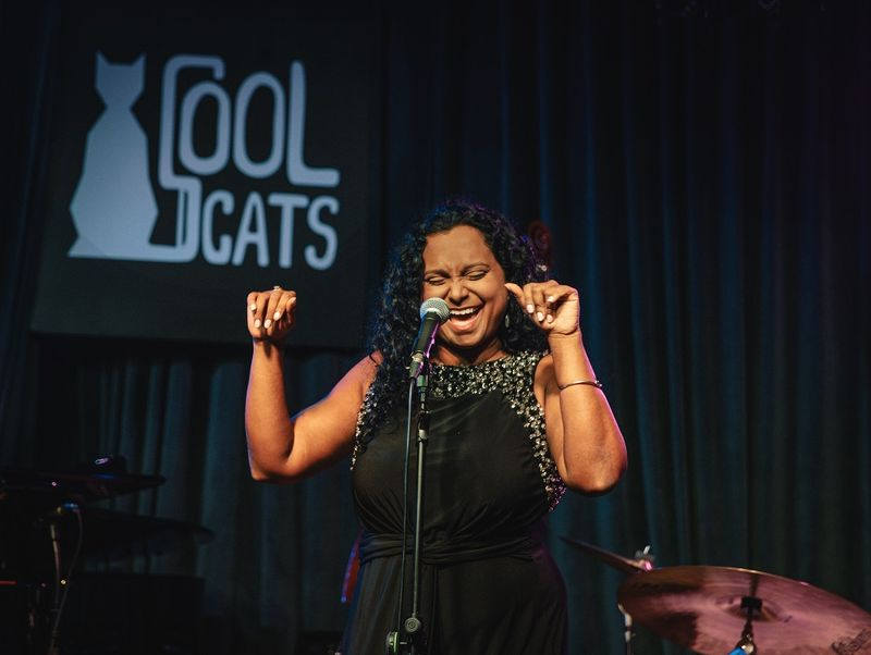woman singing at cool cats bar in singapore