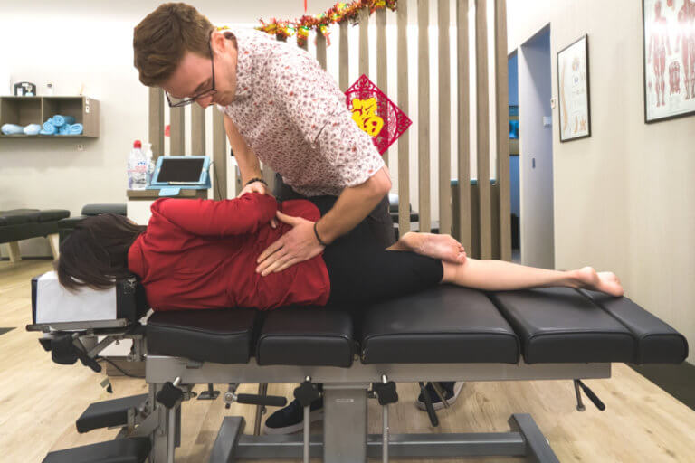 chiropractor performing spinal alignment in a clinic in singapore