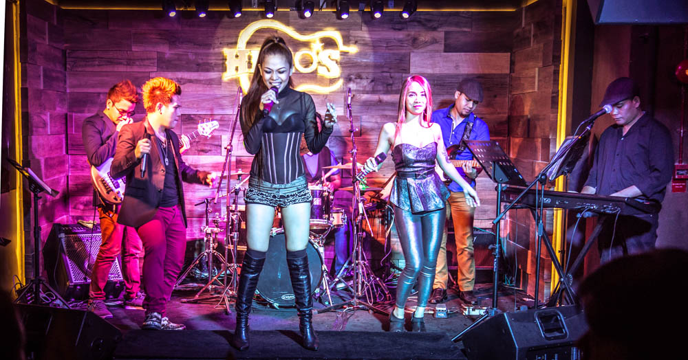 a group of women performing at hero's bar in singapore