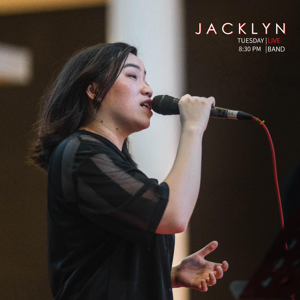 woman performing live at level up bar in singapore