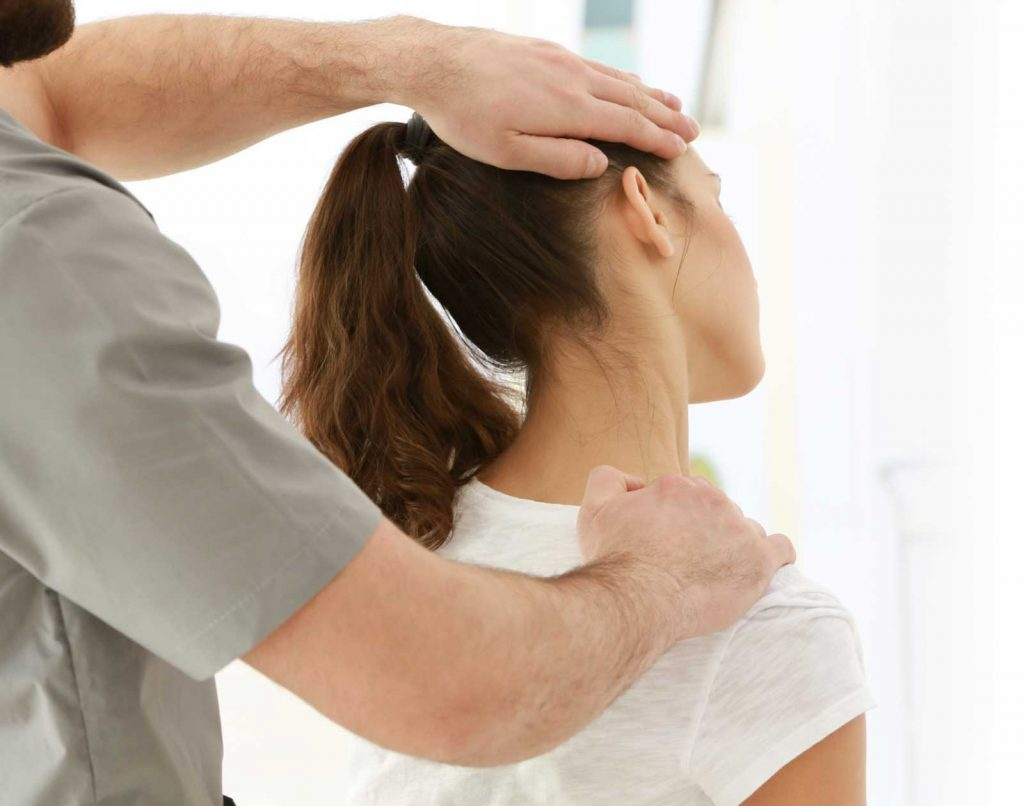 chiropractor performing neck alighnment in natural healing clinic singapore