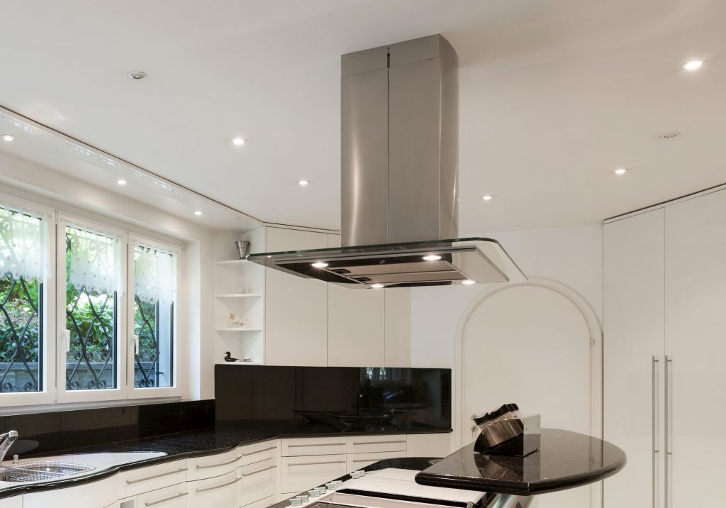 a classy silver with glass cooker hood i the kitchen