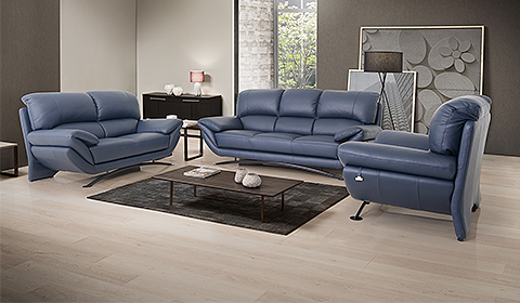 Living area with with blue sofa and center table table by Lorenzo furniture in JB