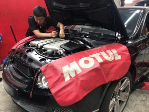 car technician servicing car
