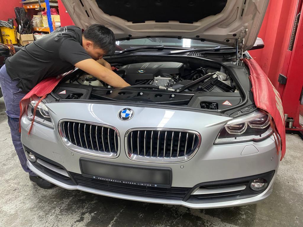 Elite Car Ventures car technician inspecting a car