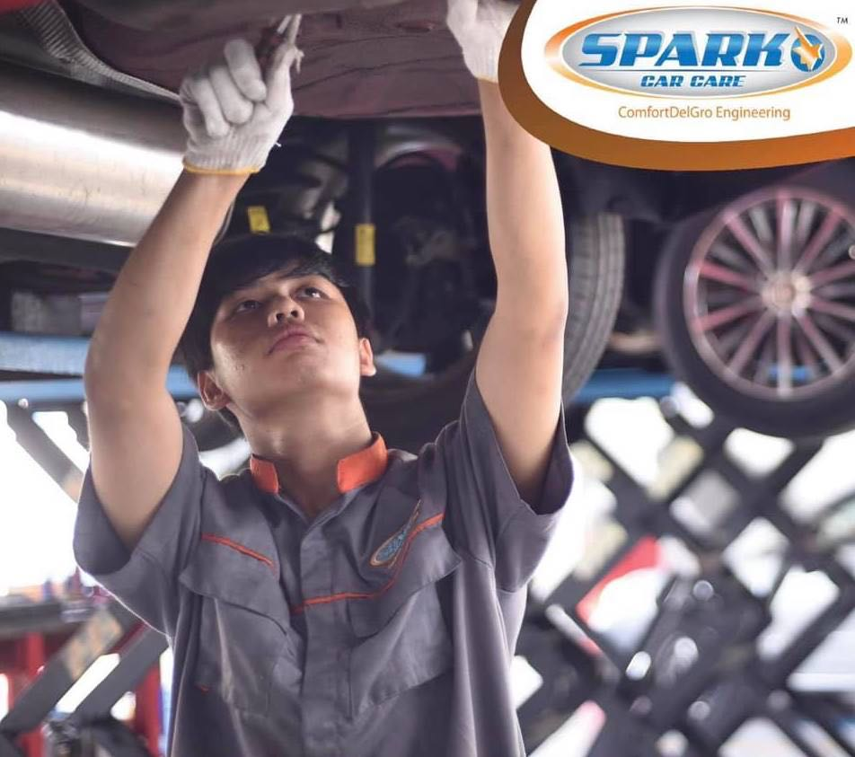 Spark Car Care technician doing vehicle servicing
