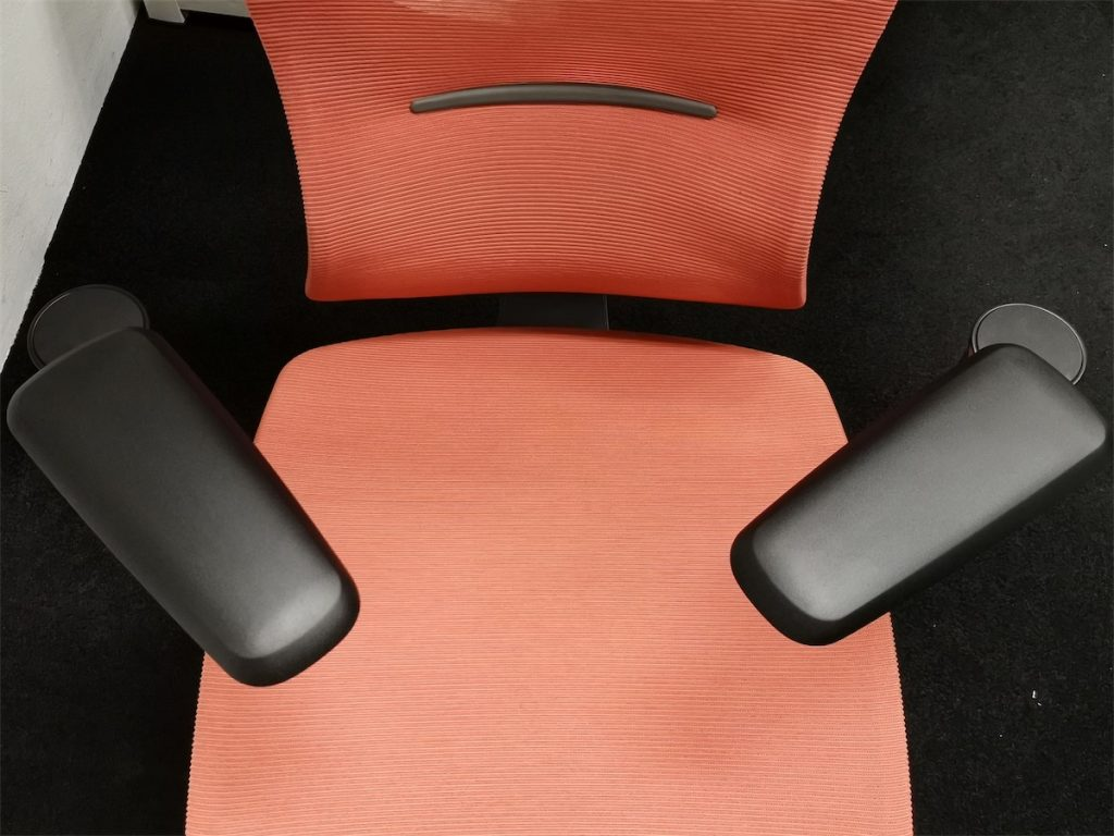Top view of the ErgoTune chair armrests when rotated